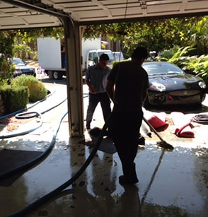 Providing 24 hour emergency flood service in a San Diego garage in the early morning