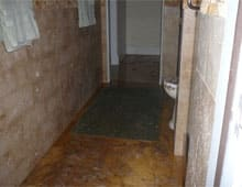 Bathroom after flood: Sewage back up in bathroom.