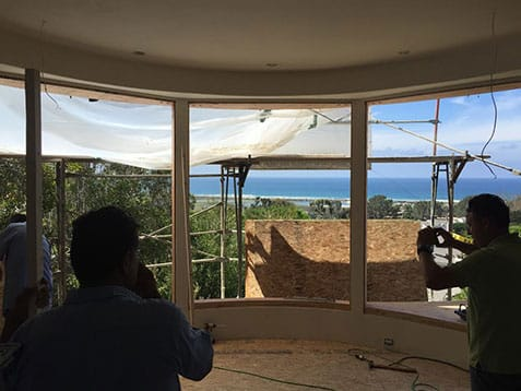 Installing curved windows during a fire damage repair job
