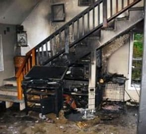 Burnt home and stairwell before San Diego fire damage repair