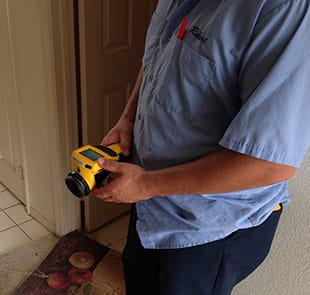 Robert uses a humidity sensor while mold testing in San Diego