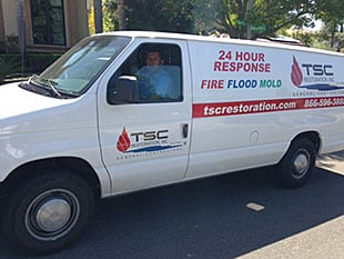 Work van on site for a San Diego water damage repair job