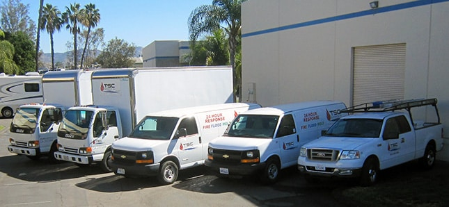 A few of our trucks gather before a fire damage repair job at a bank
