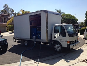 Truck with deployed turbodriers for a water damage cleanup job