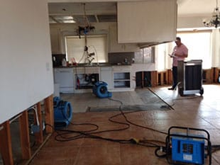 Using driers in a kitchen during a El Cajon flood damage repair job
