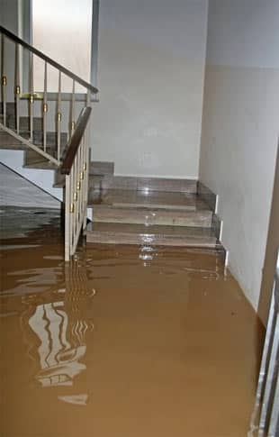 flood water covers a staircase in a Santee home