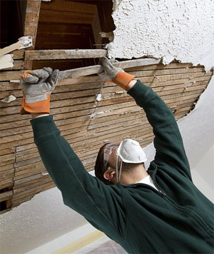 Chula vista flood damage repair specialist removes damaged ceiling in Rancho del Ray
