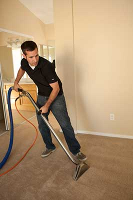 cleaning a carpet after a water damage restoration in Temecula, CA