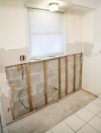 drywall removed during water damage repair in Santa Ana, due to excessive mold
