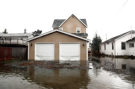 Flooded home in Mira Mesa, CA with caved in garage doors
