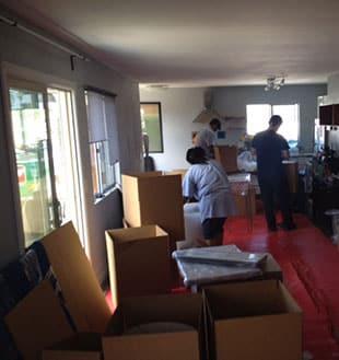 Mira Mesa water damage repair team packs out home contents