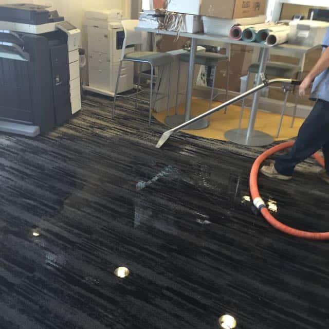 Oceanside water damage repair of flooded carpet in an office