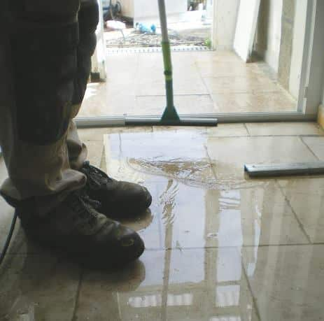 Removing water with a squeegee