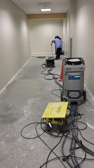 water damage restoration equipment deployed in a hallway