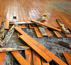 Flood damage repair in San Diego - pulling up floorboards