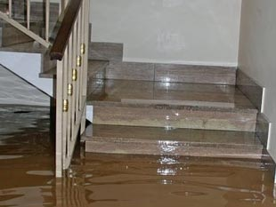 the first floor of this home was flooded and water reached above the first step