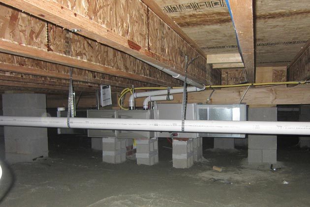 a HVAC crawl space exposed to water damage