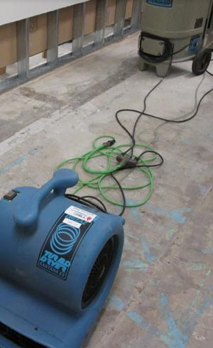 flooded basement cleanup in San Diego using a turbo dryer dehumidifier to prevent black mold growth